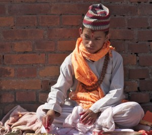 Young boy mixing tikka dyes