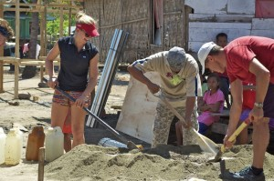 Mixing cement for the foundations with a paddle!