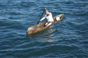 Helen mastering the art of paddling a dugout canoe.