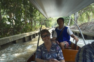 Angela with our boatman behind