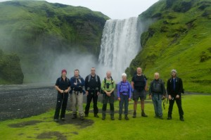 The triumphant group in front of Skogarfoss