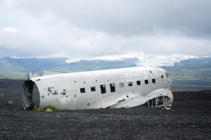 The remains of the 1973 emergency landing with the Myrdalsjokull Glacier behind