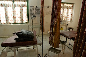 The examination room where the equipment is antiquated and dirty.