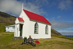Oskar relaxing at Husavik church