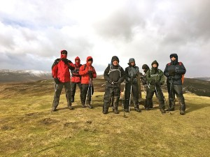 Standing firm in the strong winds on Crug Mawr
