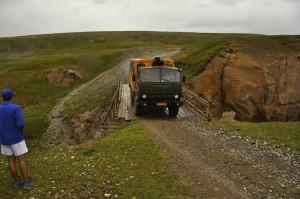 Sasha brings the lorry across the fragile bridge